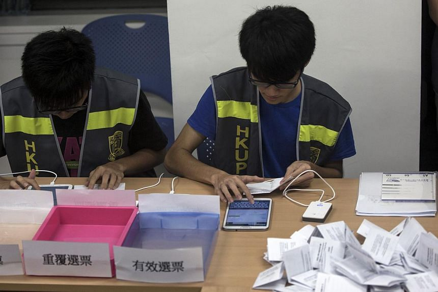 Electoral assistants count ballots at a polling station after the last day of civil referendum held by the Occupy Central organisers in Hong Kong on June 29, 2014. More than 780,000 votes were cast by the final day of an unofficial referendum on demo