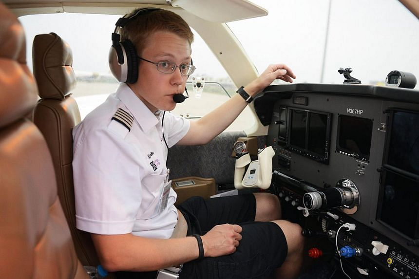 US pilot Matt Guthmiller sits in the cockpit of his single-engined Beechcraft A36 Bonanza aircraft before his departure from the Dr Babasaheb Ambedkar International Airport in Nagpur on June 27, 2014. -- PHOTO: AFP