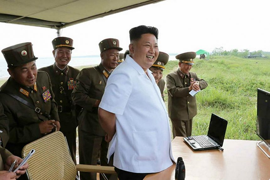 This undated picture released from North Korea's official Korean Central News Agency (KCNA) on June 27, 2014 shows Kim Jong Un inspecting the test firing of a missile at an undisclosed place in North Korea. North Korea confirmed on Monday its second
