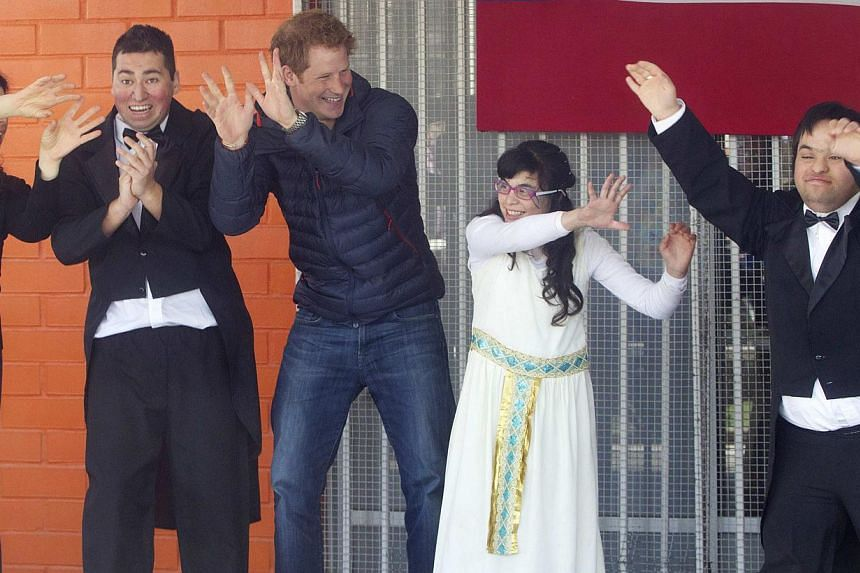 Britain's Prince Harry (third from left) participates in a performance during his visit to a school for children with disabilities during the last day of his tour in Santiago June 29, 2014. -- PHOTO: REUTERS