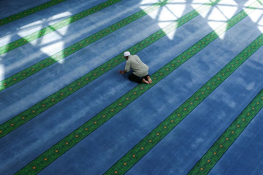 A Malaysian Muslim prays during a lunch break on the 2nd day of the holy month of Ramadan inside a mosque in Kuala Lumpur June 30, 2014. Muslims are observing the fasting month of Ramadan, Islam's holiest month, during which observant believers fast