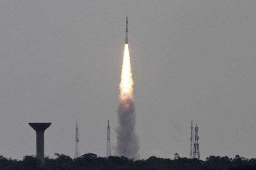 India's Polar Satellite Launch Vehicle (PSLV-C23), carrying five satellites, lifts off from the Satish Dhawan Space Centre in Sriharikota, north of the southern Indian city of Chennai on June 30, 2014. Newly elected Prime Minister Narendra Modi