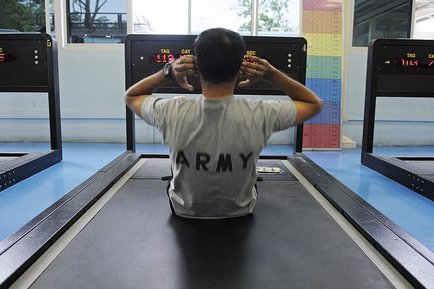 An NS man at the sit-ups station at Maju Camp.EVERY career and citizen soldiers will find it easier to train for - maybe even pass - their annual physical fitness test, as the Singapore Armed Forces finalise changes to simplify Individual Physi