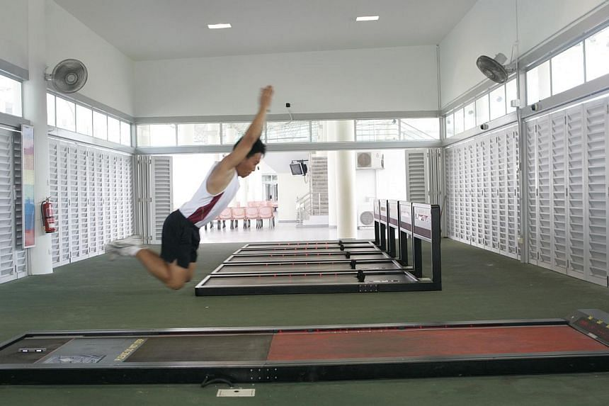 An NSman doing the standing broad jump, one of the exercise in the IPPT. -- PHOTO: ST FILE
