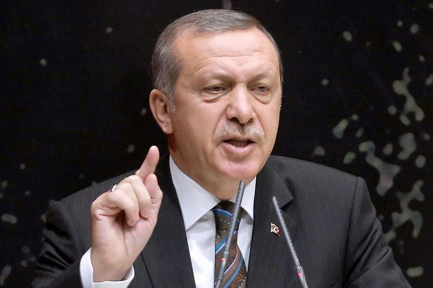 Turkey's Prime Minister Tayyip Erdogan gestures as he delivers a speech during a meeting of ruling Justice and Development Party (AKP) at the party headquarters in Ankara on June 25, 2014. -- PHOTO: AFP