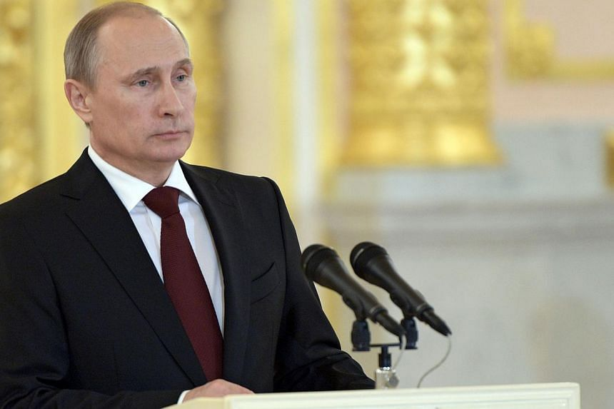 Russia's President Vladimir Putin attends a ceremony of accepting the credentials of the new foreign ambassadors in Aleksandrovsky (Alexander's) Hall at the Grand Kremlin Palace in Moscow, on June 27, 2014.The leaders of Germany and France warn