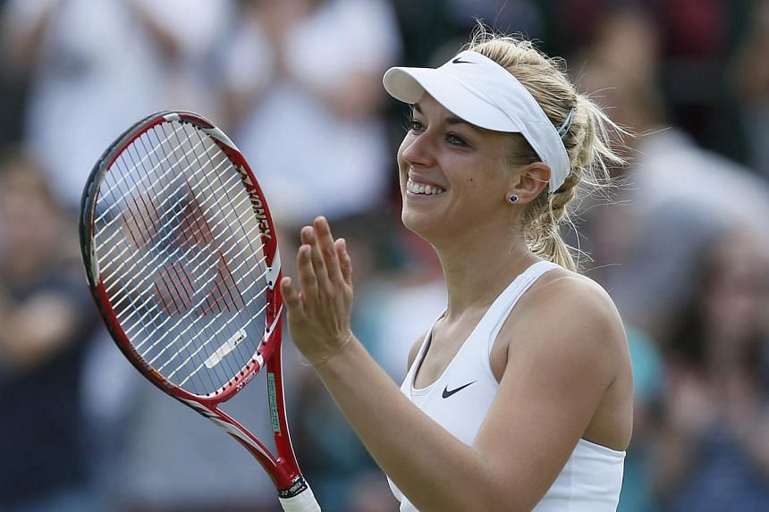 Sabine Lisicki of Germany reacts after defeating Yaroslava Shvedova of Kazakhstan in their women's singles tennis match at the Wimbledon Tennis Championships, in London on July 1, 2014. -- PHOTO: REUTERS
