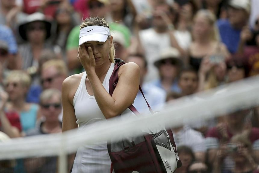 Maria Sharapova of Russia reacts after being defeated by Angelique Kerber of Germany in their women's singles tennis match at the Wimbledon Tennis Championships, in London on July 1, 2014.Maria Sharapova suffered more Wimbledon heartache as the