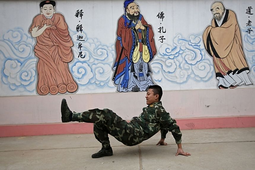 A student performs a dance during a break at the Qide Education Center in Beijing on Feb 26, 2014. -- PHOTO: REUTERS