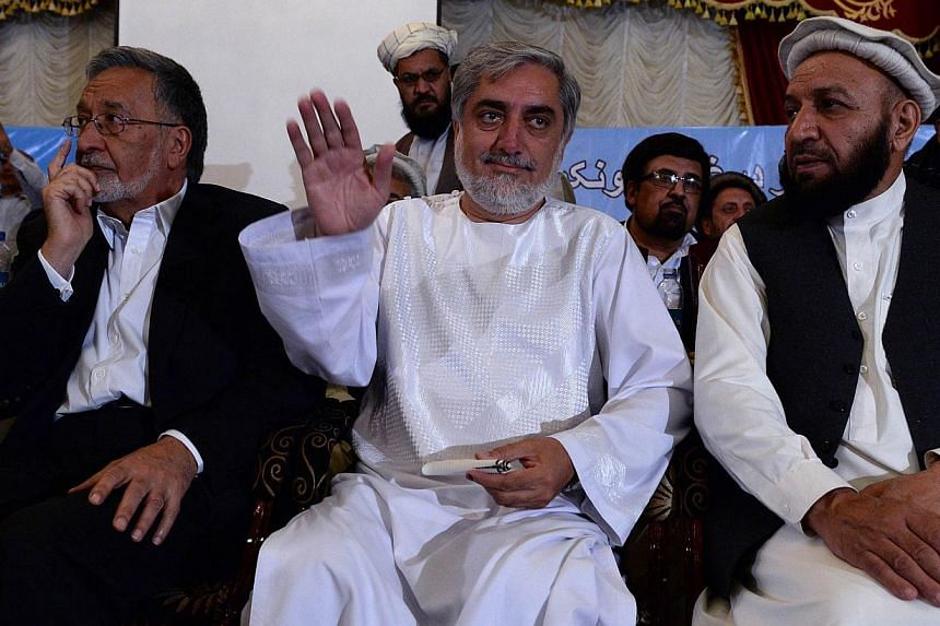 Afghan presidential candidate Abdullah Abdullah (C) gestures during a gathering with tribal elders in Kabul June 28, 2014. Abdullah has vowed to reject the country's general election result, saying he was the victim of massive ballot-box stuffing in