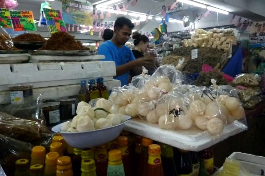 Turtle eggs are openly sold in a bazaar at Kuala Terengganu, the capital city of the state of Terengganu. There is no outright ban on the consumption of turtle eggs in Peninsular Malaysia, unlike the case in Sabah and Sarawak. -- ST PHOTO: CHEONG POH