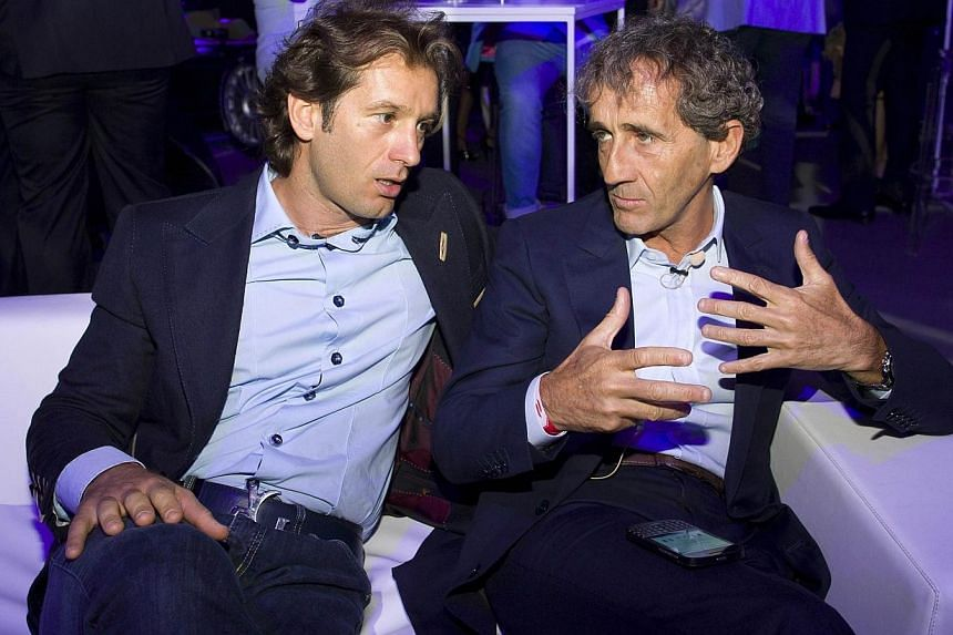 Italian former Formula One racing driver Jarno Trulli (left) speaks with French former Formula One racing driver Alain Prost (right) at the Global Launch of the all-electric FIA Formula E Championship in London on June 30, 2014.Grand Prix great