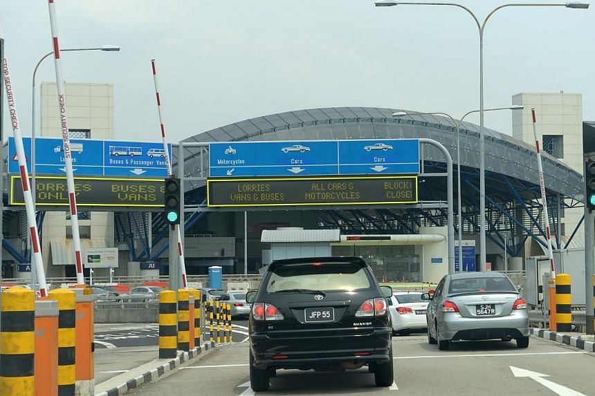 The Singapore Immigrations and Customs checkpoint at Tuas Second Link, as seen from Johor, Malaysia. Foreigners driving into Singapore will have to pay more from August, the Land Transport Authority announced on Tuesday. -- PHOTO: ST FILE