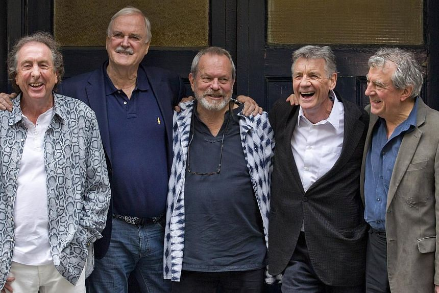 British comedy troupe Monty Python, (left-right) Eric Idle, John Cleese, Terry Gilliam, Michael Palin, and Terry Jones pose for a photograph at the back door to the London Palladium in central London on June 30, 2014. Fans arrived for the first