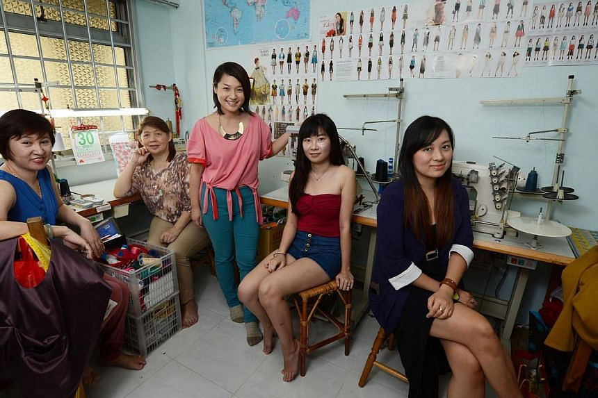 Ms Eileen Yap (standing), founder of online clothing store Noel Caleb, works with a team of home seamstresses in Singapore including (from left) Ms Mgui Choon Keow, Ms Jenny Tan, Ms Yvonne Ng and Ms Audrey Ti, in order to avoid dealing with unethical