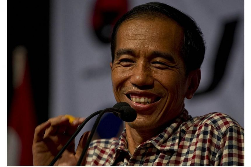 Indonesian frontrunner presidential candidate Joko Widodo, popularly known by his nickname Jokowi, addresses supporters during campaign for the July 9, 2014 election in his hometown in Solo city, located in central Java island on June 14, 2014. Mr Wi