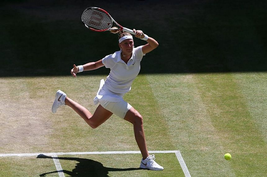 Czech Republic's Petra Kvitova returns to Czech Republic's Lucie Safarova during their women's singles semi-final match on day ten of the 2014 Wimbledon Championships at The All England Tennis Club in Wimbledon, south-west London on July 3, 2014. --