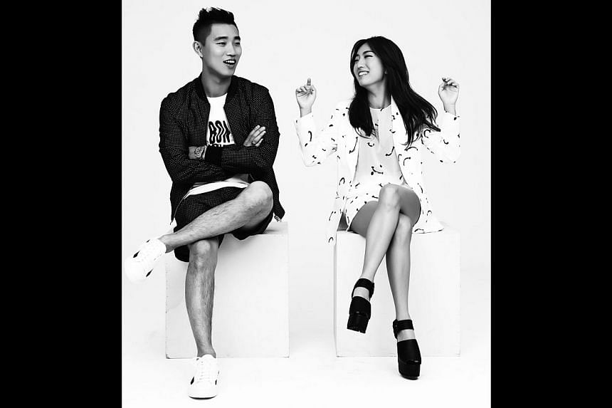K-pop stars Kang Gary (left) and Jung In will perform at the NTU Fest next month. Organisers include students (from left, 1st row) Foo Rong En, Wu Guo Yi, Loh Jia Wei, Anna Yor, Laura Lum, Tan Hui Jun, Kimberly Lee, (2nd row) Mervyn Lim, Tan Shi Wei,