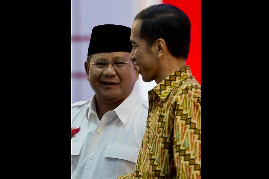 Presidential rivals Mr Prabowo Subianto (left) and Mr Joko Widodo. Although both would seek to strengthen Asean, Mr Subianto, a former general, is likely to take a harder line on foreign policy.