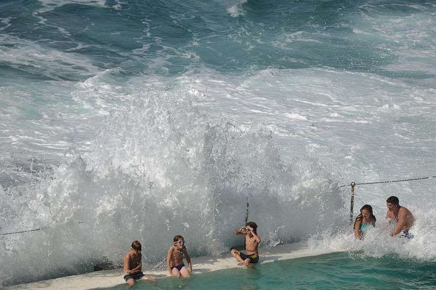 People in an ocean pool at Sydney's famous Bondi Beach. Hundreds of the world's top marine scientists have called for Western Australia to ditch its shark cull policy, arguing there is no evidence that it makes beaches safer. -- PHOTO: AFP