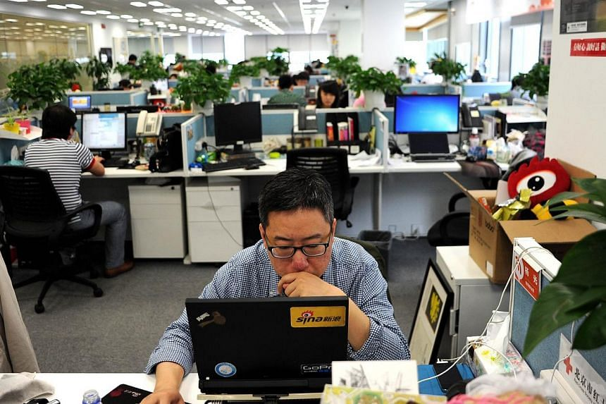 A man using a laptop at an office of Sina Weibo, widely known as China's version of Twitter, in Beijing. A People's Daily article seeks to argue not only that China has the right to set its own rules and regulations for the Internet, but also that an