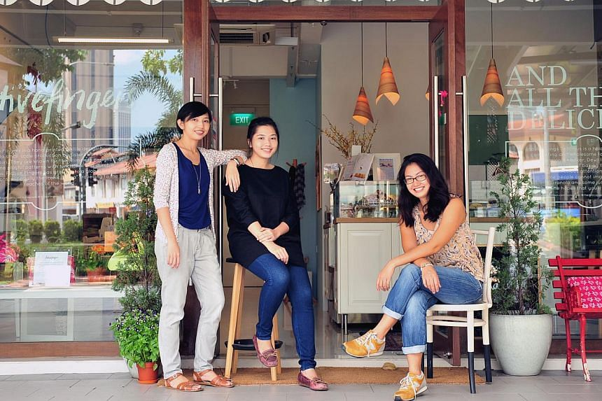 Fictive Fingers sister-owners (from far left) Hani and Aisah Dalduri and And All Things Delicious owner Dewi Imelda Wadhwa opened their Crawford Lane shop in May. -- ST PHOTO: STEFFI KOH