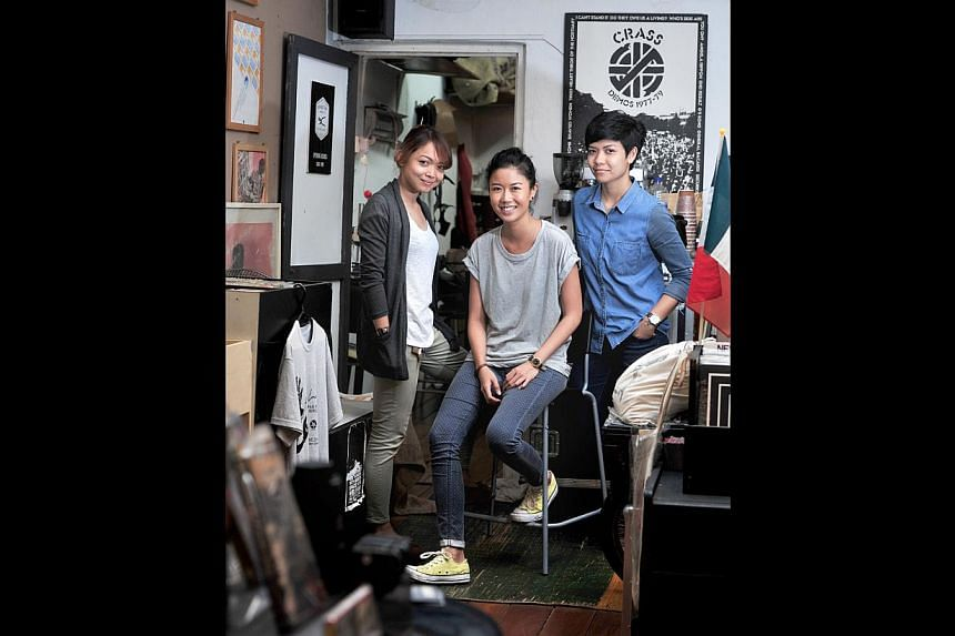 Maketh Project founders (from left) Addynna Azlinor, 28, Adlina Adil and Rozeryna Rothman, 29, are sharing a space with Straits Records in Bali Lane. -- ST PHOTO: STEFFI KOH