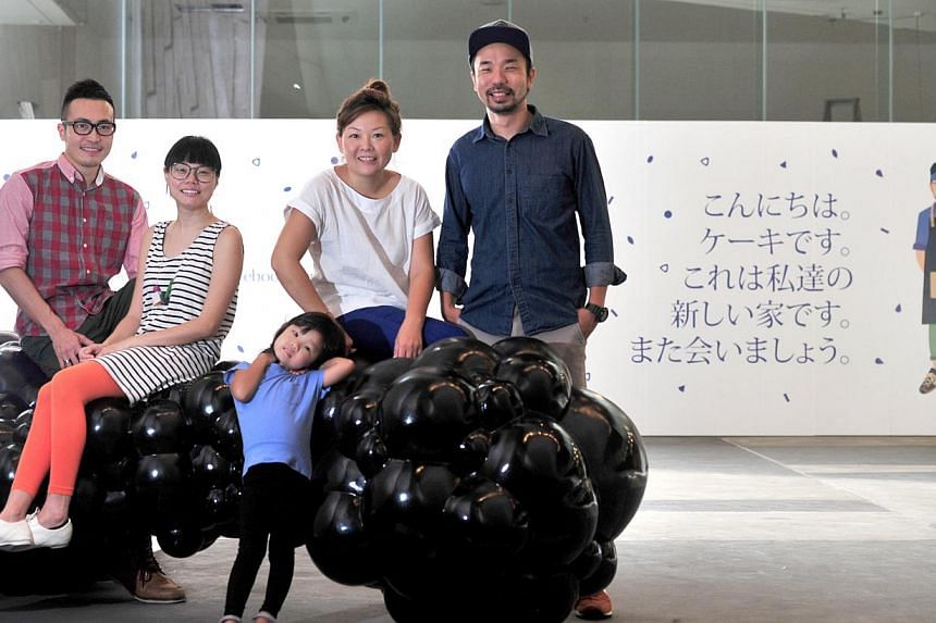 The little drom store owners (from far left) Stanley Tan, 33, and Antoinette Wong and Kki owners Delphine Liau and Kenneth Seah, 42, (with daughter Shannon, three) will have a new home at the School of the Arts. -- ST PHOTO: STEFFI KOH