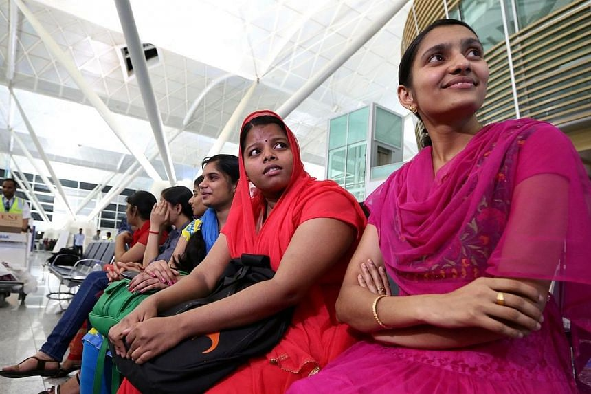 Some of the 46 Indian Nurses, held hostage by Islamic militants in Iraq, wait at the airport before flying home on July 4, 2014, in the city of Arbil in the autonomous Kurdistan region of northern Iraq.A group of 46 Indian nurses who were trapp