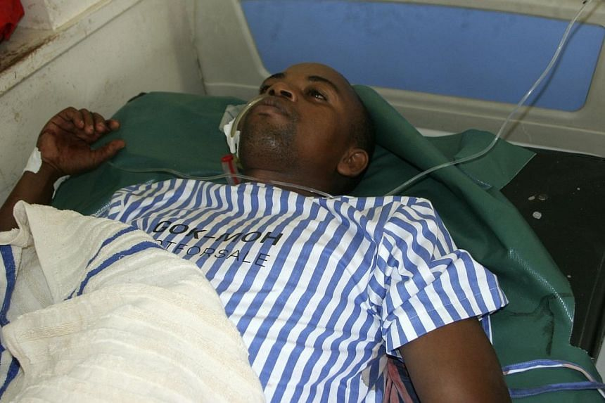 A resident receives treatment at the King Fahad hospital after he was shot when gunmen attacked Hindi village, near Kenya's coastal town of Lamu, July 6, 2014.Gunmen killed at least 29 people in raids on two separate areas on the Kenyan coast,