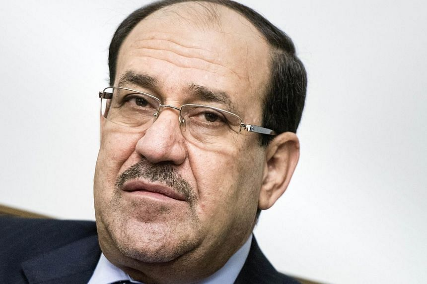 A file picture taken on June 23, 2014 shows Iraqi Prime Minister Nuri al-Maliki meeting with US Secretary of State (unseen) at the Prime Minister's Office in Baghdad.Iran said on Sunday that it supports Mr Nuri al-Maliki's bid to stay on as Ira