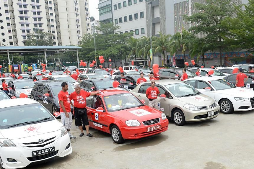 "At the launch of the PAYM Loves Red campaign yesterday, 49 ""car ambassadors"" distributed vehicle flags and side mirror covers with the national flag to residents in the constituency."