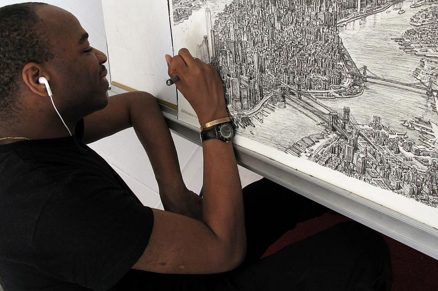 British architectural artist Stephen Wiltshire - who is a savant with exceptional talent in art, music and memory - drawing an aerial view of Manhattan. Known for intricate drawings of cityscapes, he will be in Singapore later this month to draw the