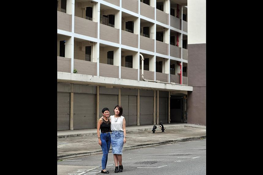 Ms Malvina Tan (in black top, with fellow team member Aurial Lee) on getting the karung guni man and former resident of the chap lau chu to star in the project, Chap Lau Chu: The Reopening Of Commonwealth Drive, Tanglin Halt. -- PHOTO: STEFFI KOH