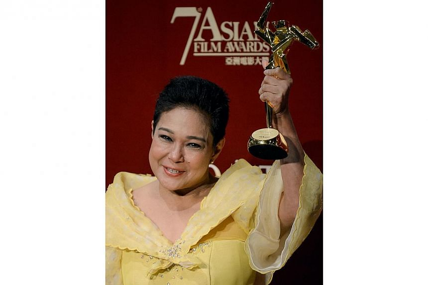 This file photo taken on March 18, 2013 shows Philippine actress Nora Aunor posing with the Best Actress Award at the 7th Asian Film Awards in Hong Kong. Philippines President Benigno Aquino on July 1, 2014 defended a controversial decision he made t