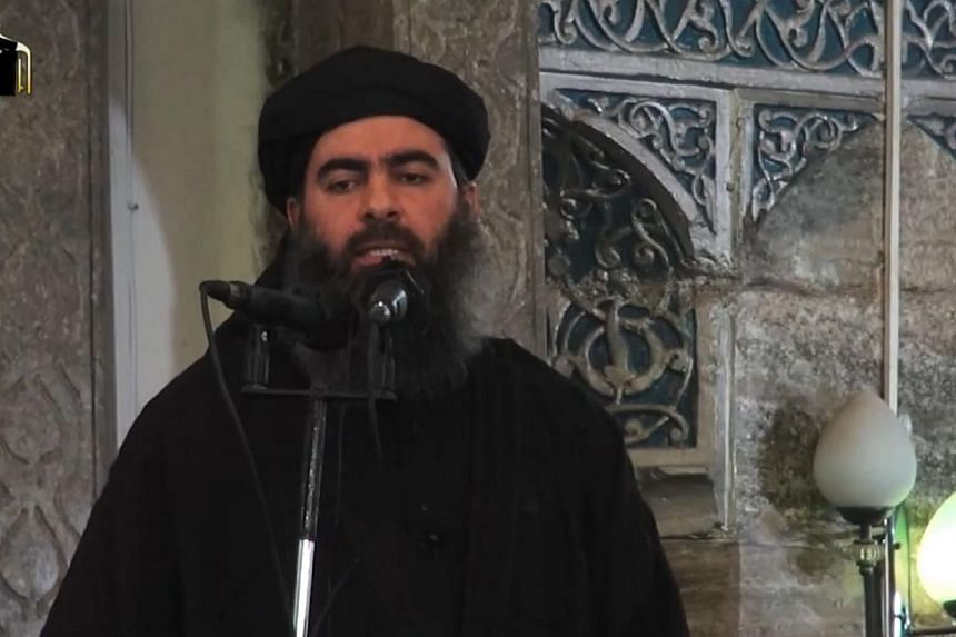 An image grab taken from a propaganda video released on July 5, 2014 by al-Furqan Media allegedly shows the leader of the Islamic State jihadist group, Abu Bakr al-Baghdadi, aka Caliph Ibrahim, adressing Muslim worshippers at a mosque in the militant
