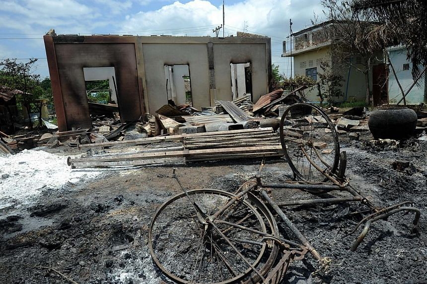 A general view shows a destroyed building at a cemetery after a riot on the outskirts of Mandalay, central Myanmar on July 5, 2014.Muslims in Myanmar's second-largest city accused police on Saturday of standing by as a Buddhist mob went on a
