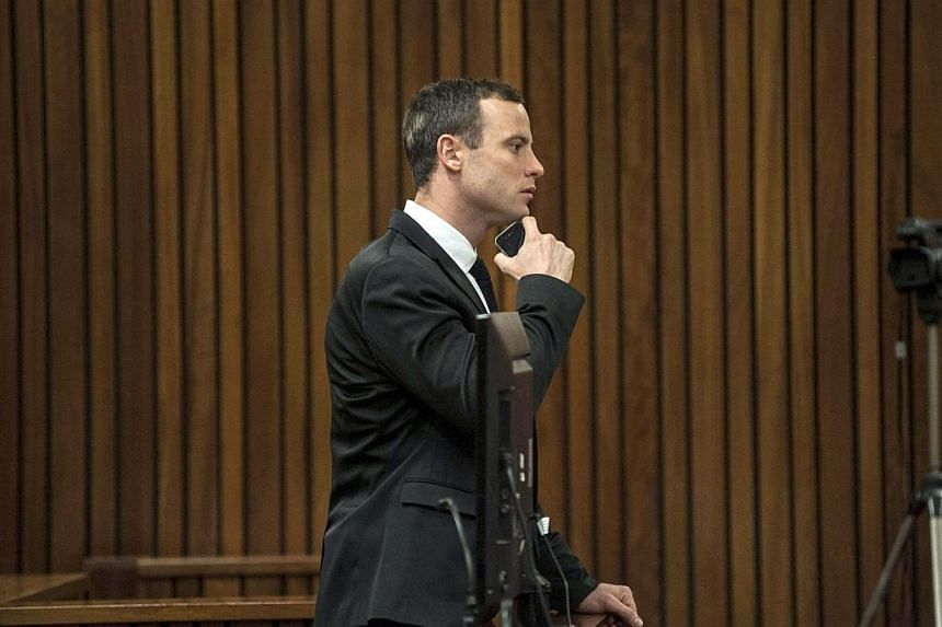 Olympic and Paralympic track star Oscar Pistorius looks on during his trial, at the North Gauteng High Court in Pretoria July 7, 2014.South African prosecutors on Monday sought to show Oscar Pistorius's sports doctor overstated his immobility w