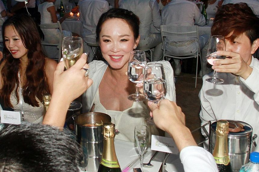 Local actress Fann Wong attends the Diner En Blanc picnic, which will be her last public appearance before delivering her baby. -- ST PHOTO: LAU FOOK KONG