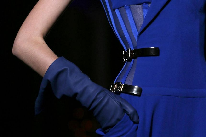 A model presents a creation by Italian designer Donatella Versace as part of her Haute Couture Fall/Winter 2014-2015 fashion show in Paris on July 6, 2014. -- PHOTO: REUTERS