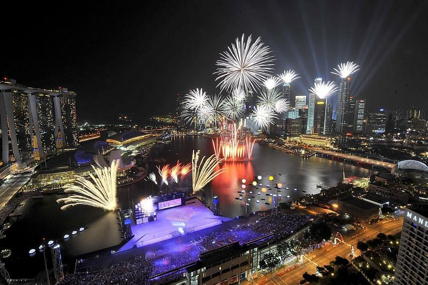 Fireworks lighting up the night sky at the Marina Bay Floating Platform during the National Day Parade (NDP) on Aug 9, 2011. -- ST PHOTO: JAMIE KOH