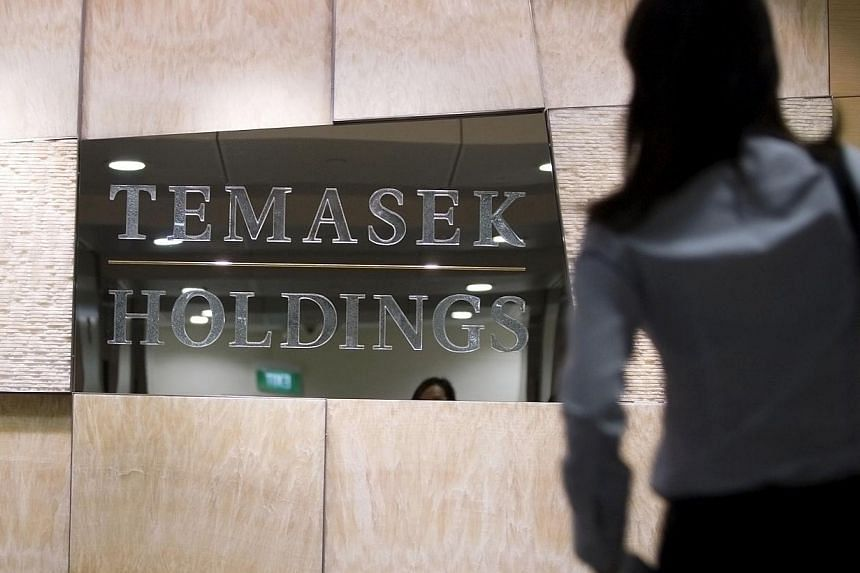 Singapore state investor Temasek Holdings Pte Ltd said it would continue to invest in Chinese financial institutions and it was comfortable with its holdings in Chinese banks. -- PHOTO: BLOOMBERG
