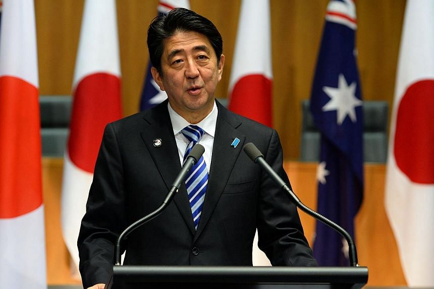 Japanese Prime Minister Shinzo Abe speaks at a joint press conference with his Australian counterpart Tony Abbott at the Parliament House in Canberra on July 8, 2014.Japanese Prime Minister Shinzo Abe plans to launch a female-focused version of