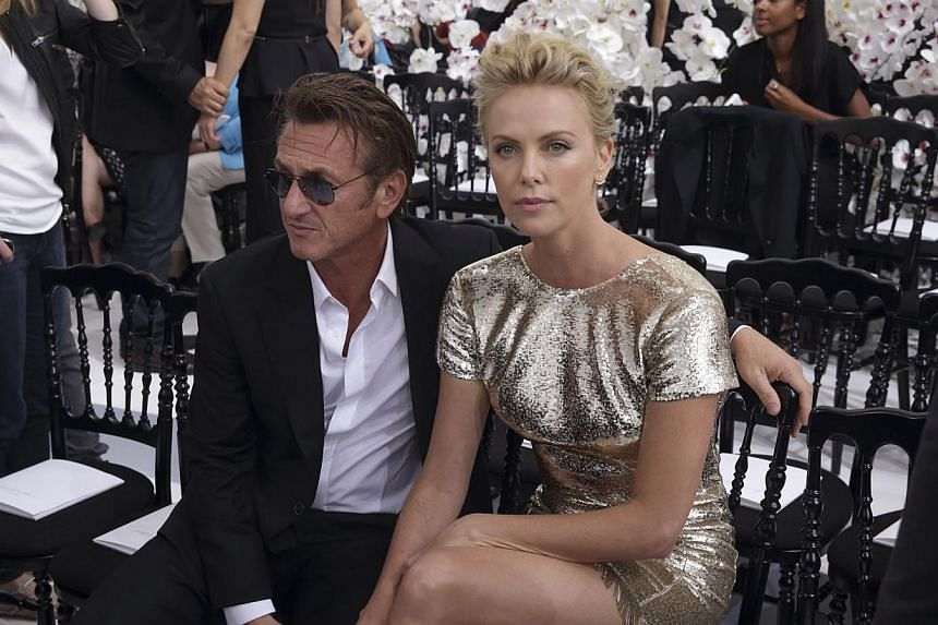 Actors Sean Penn and Charlize Theron before the French fashion house Christian Dior Haute Couture Fall/Winter 2014-2015 fashion show by Belgian designer Raf Simons in Paris on July 7, 2014. -- PHOTO: REUTERS