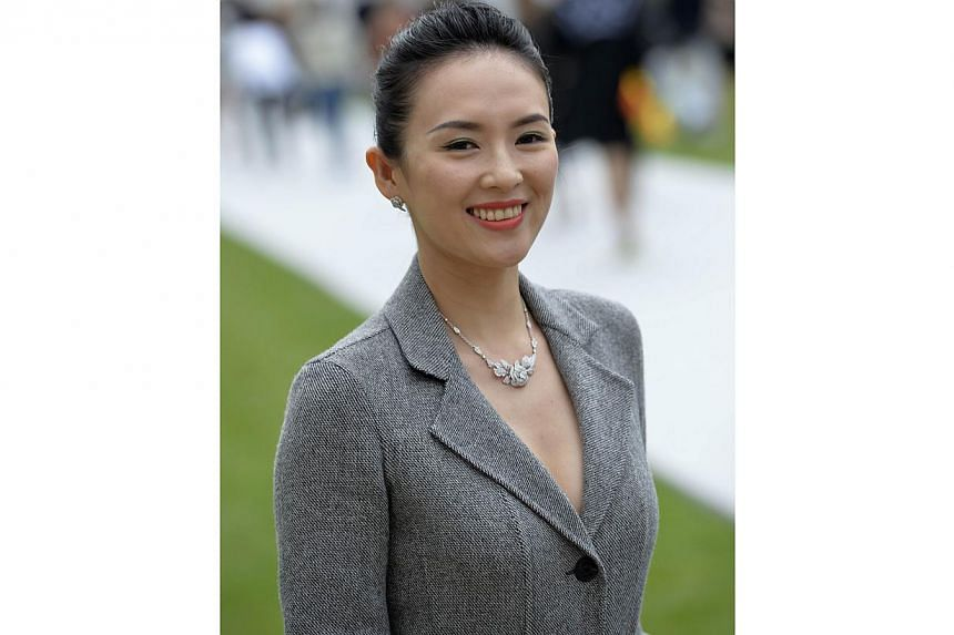 Chinese actress Zhang Ziyi poses upon arrival at the Christian Dior 2014/2015 Haute Couture Fall-Winter collection fashion show in Paris on July 7, 2014. -- PHOTO: AFP