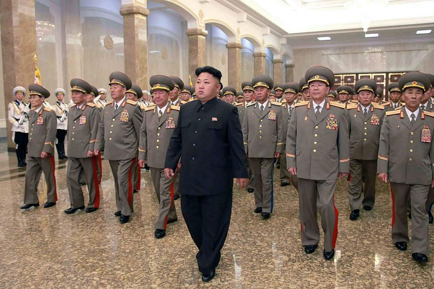 North Korean leader Kim Jong Un (centre) visits the Kumsusan Palace of the Sun at midnight on Tuesday on the occasion of the 20th anniversary of the demise of President Kim Il Sung, in this photo released by North Korea's Korean Central News Agency (