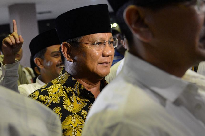 Indonesian presidential candidate Prabowo Subianto (centre) arriving at a Ramadan concert in Jakarta on July 2, 2014. -- PHOTO: AFP