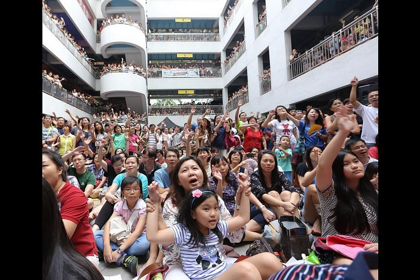 Dawn Gan and other xinyao singers performed to a nostalgia-filled crowd of 2,000 fans at Bras Brasah Complex (above) on Sunday. -- ST PHOTO: ONG WEE JIN