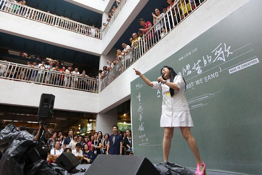 Dawn Gan (above) and other xinyao singers performed to a nostalgia-filled crowd of 2,000 fans at Bras Brasah Complex on Sunday. -- ST PHOTO: ONG WEE JIN