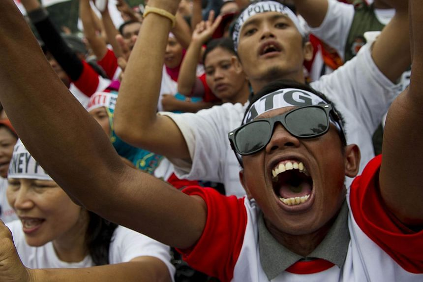 Supporters of front runner Joko Widodo at a campaign rally in Jakarta on June 26. The popularity gap between Mr Joko and opponent Prabowo Subianto, a former general, has narrowed as the country goes to the polls tomorrow.
